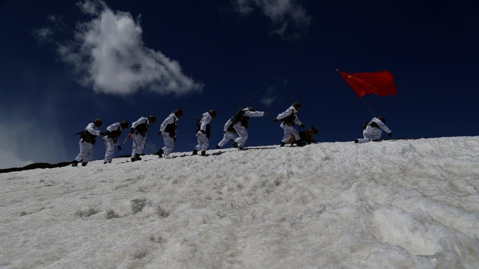 New recruits of the Chinese People's Liberation Army (PLA) patrol the border area at Ngari, Tibet Autonomous Region, China, in this file photo from April 2017.