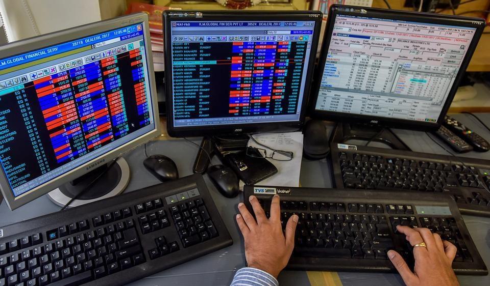 A stockbroker trades shares on a terminal in Mumbai.