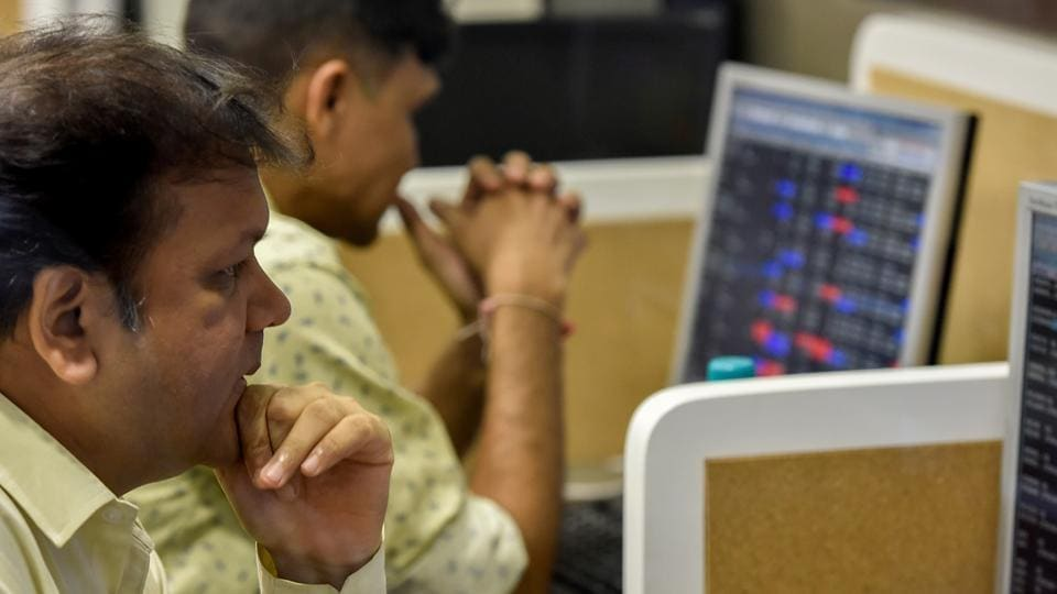 A stockbroker trades shares on a terminal, as the benchmark share index Sensex scaled new heights, at a brokerage house in Mumbai.