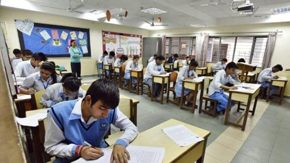 Students of Class 12 during the first day of CBSE exam at an exam centre, in Blue Bells Model School, Sector-4, in Gurgaon, India.