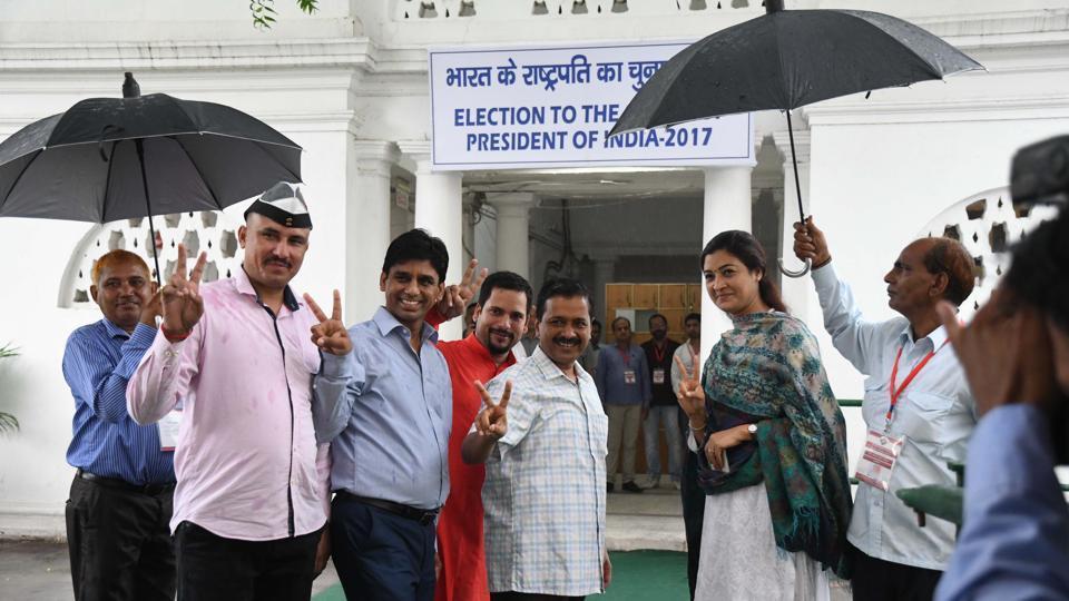 Delhi chief minister Arvind Kejriwal and legislator Alka Lamba comes out of Vidhan sabha after voting on Monday.