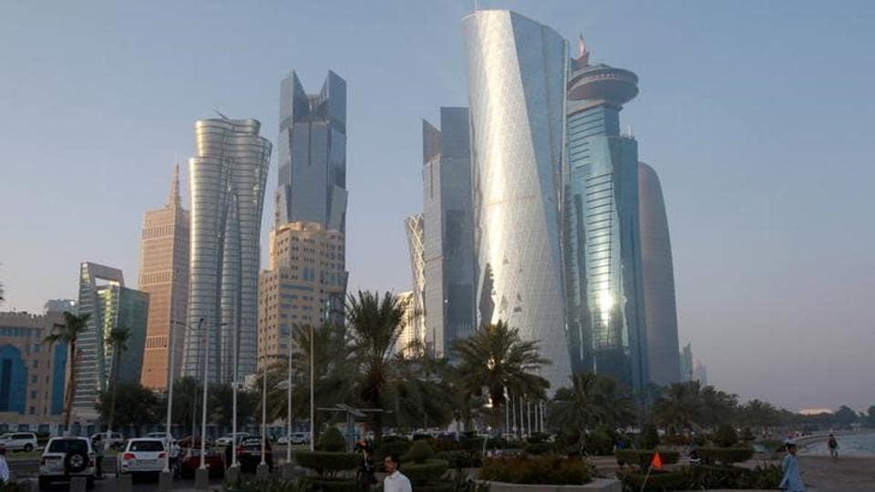A man walks on the corniche in Doha, Qatar.