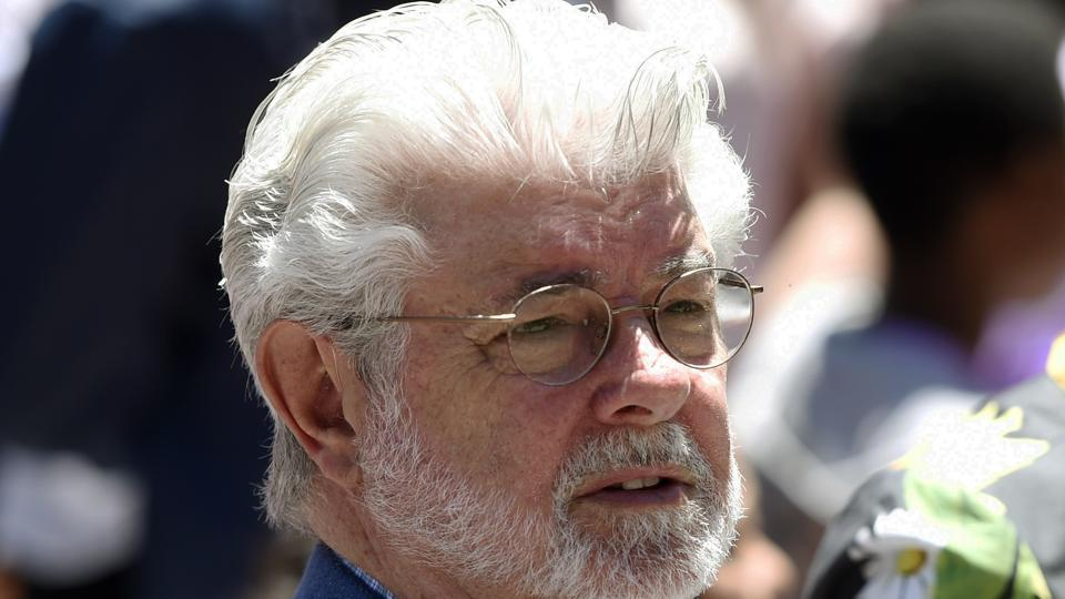 Filmmaker George Lucas listens to remarks at a news conference outside Los Angeles City Hall.