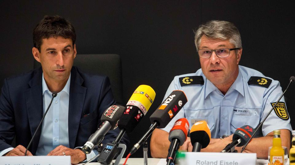 Matthias Klopfer (left), mayor of the southwestern German village of Schorndorf, and Aalen's police president Roland Eisele during a press conference to comment on disturbances at a local festival.