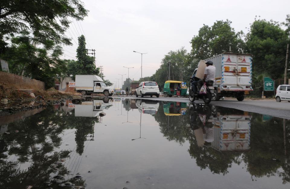 Sewage spill flood Old Delhi-Gurgaon Road near Gurgaon One housing society.