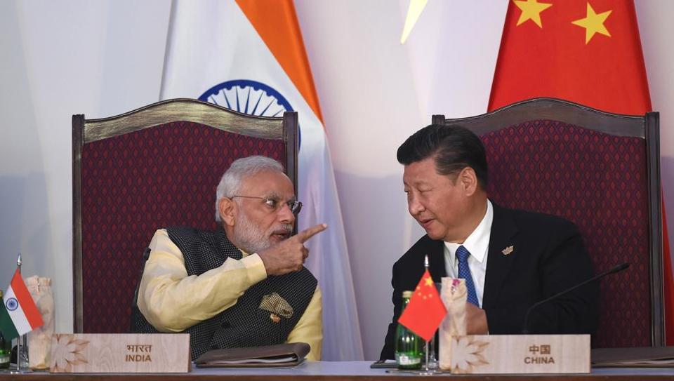 India Prime Minister Narendra Modi talking to China's President Xi Jinping during the BRICS leaders' meeting with the BRICS Business Council in October 2016.