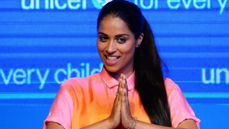 In this photograph taken on July 15, 2017, Canadian-Indian actress, YouTube star and new UNICEF Global Goodwill Ambassador Lilly Singh greets guests during a press conference in New Delhi.