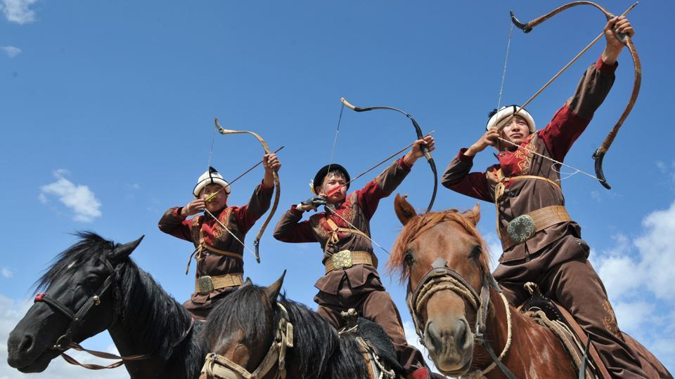 Kyrgyz men in traditional attire pose on horseback as they prepare to shoot arrows during the 'Ethno Fest' festival in the village of Ton, Kyrgyzstan. (Vyacheslav Oseledko / AFP)