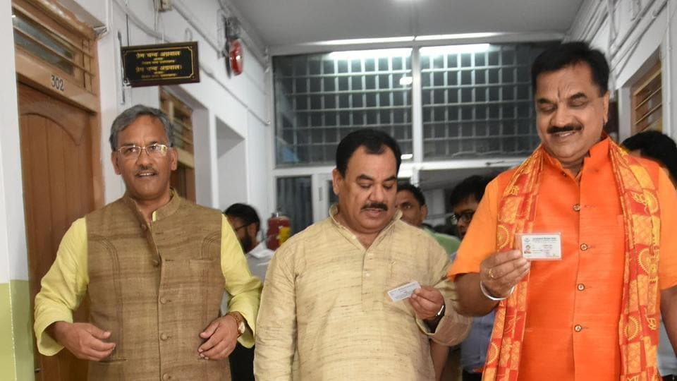 Chief minister TS Rawat, cabinet minister Harak Singh and BJP legislator Rajkumar Thakural come out of the polling centre after casting their votes for the Presidential election on Monday.