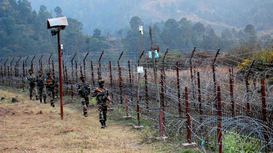 Indian Army soldiers stand guard near the Line of Control in Poonch in Jammu and Kashmir.