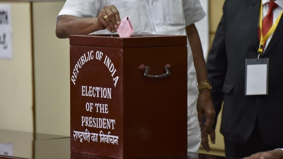 A Karnataka MLA casting his vote for the Presidential election at Vidhan Soudha in Bengaluru.