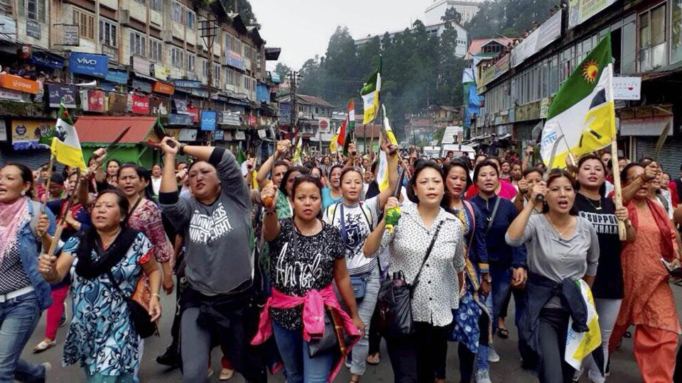 Darjeeling: Nari Morcha members during their Khukri rally for the separate state of Gorkhaland, in Darjeeling on Friday. PTI Photo (PTI7_14_2017_000153B)