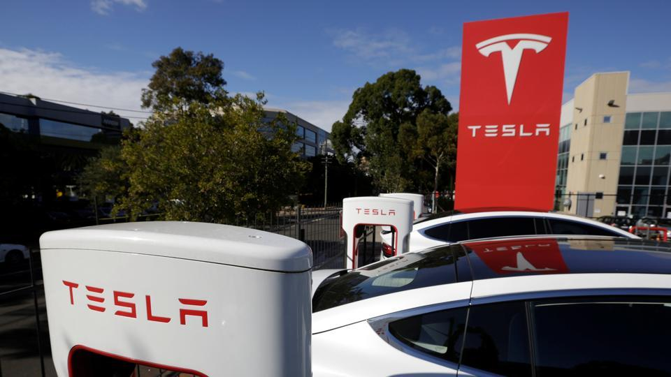 Tesla Model X cars are charged by superchargers at a Tesla electric car dealership in Sydney, Australia, May 31, 2017.