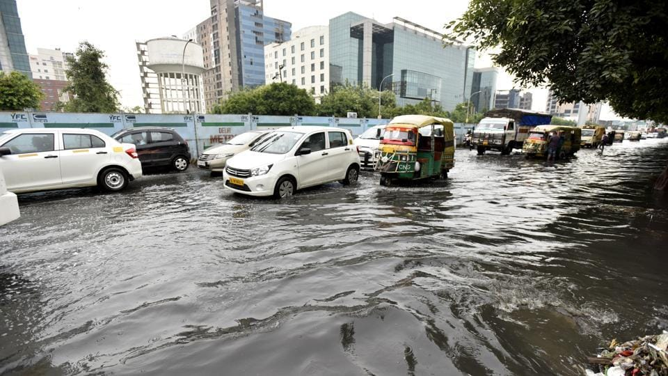 Waterlogging in Sector 62 after heavy rain. Instances of congestion and overflowing drains were reported from many areas on Monday.