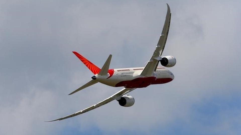 An Air India Airlines Boeing 787 dreamliner takes part in a flying display during the 50th Paris Air Show at the Le Bourget airport near Paris.
