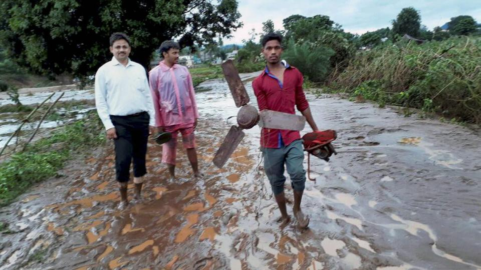 In Rayagada, four road bridges were washed away, while in Kalahandi, Hati river was flowing over the bridge connecting Junagad and Bhawanipatna.  (PTI)