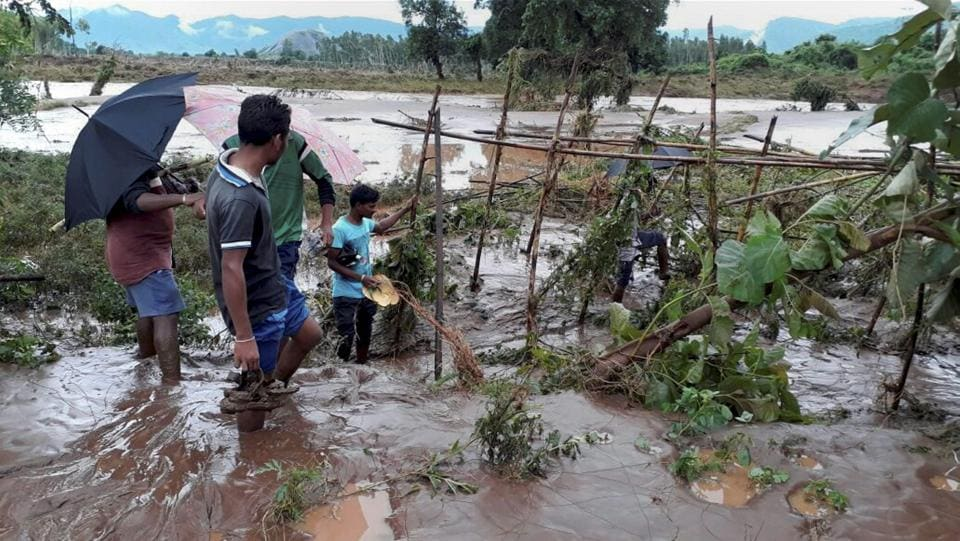 Volunteers checking  the water level  of river Nagabali during flash flood in Rayagada district, Odisha. Emergency medicine stock including anti-snake venom have been stored in community health centres of the district. (PTI)