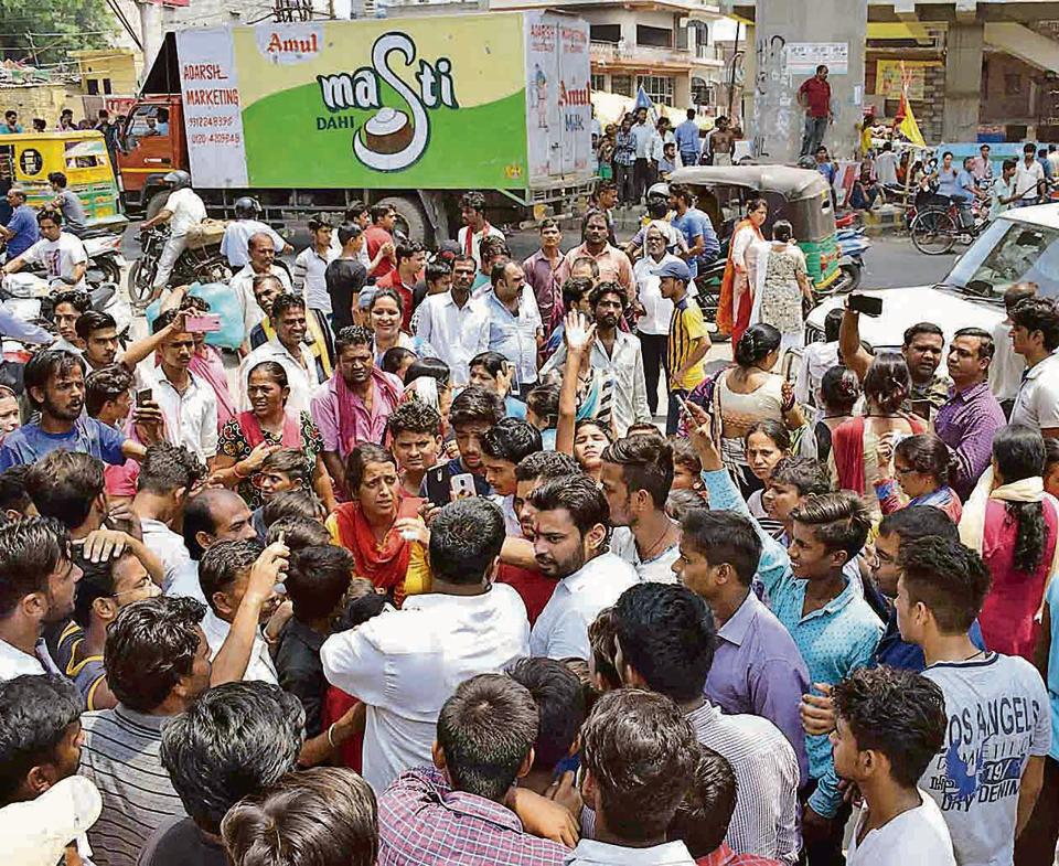 Locals from Lajpat Nagar protest against the suspicious death of the 24-year-old man outside Sahibabad police station on Tuesday .