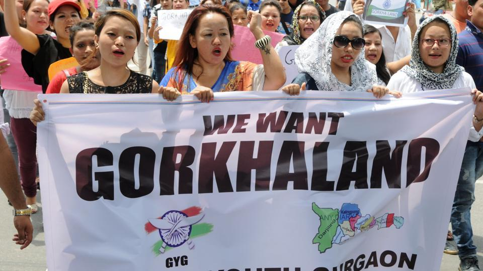 Gorkha protesters hold a banner during a rally in Gurgaon in support of a separate Gorkhaland state in Darjeeling.
