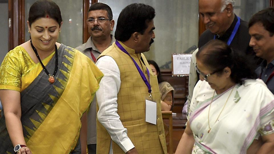 Union minister Smriti Irani and Lok Sabha Speaker Sumitra Mahajan cast their vote during Presidential election, in New Delhi on Monday.