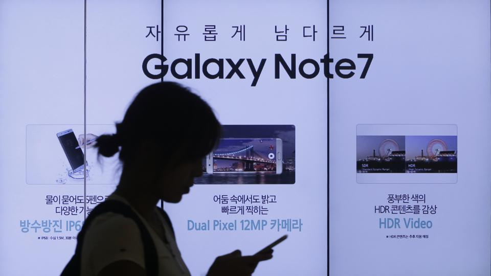 A woman walks by an advertisement of Samsung Electronics' Galaxy Note 7 smartphone at the company's showroom in Seoul, South Korea.