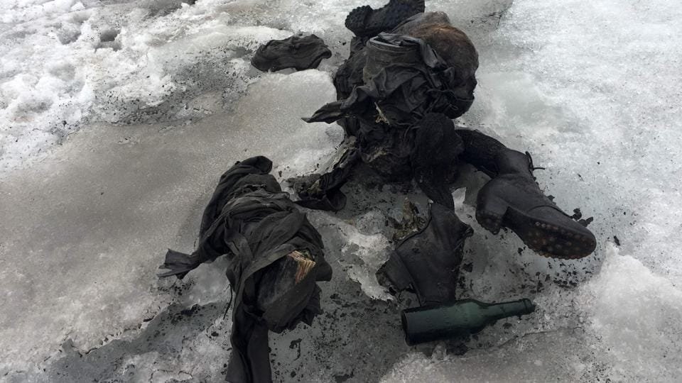 This handout picture distributed on July 18, 2017 by a Swiss cable cars company shows the mummified remains of a Swiss Couple who went missing 75 years ago and who were found in a glacier in the Diablerets mountains, in southern Switzerland. The perfectly preserved bodies lay close to each other, with their backpacks, a bottle, a book and a watch.