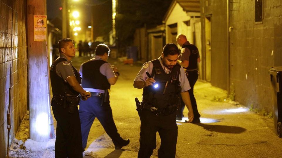 Representative Image   Chicago Police officers investigate the crime scene where a man was shot in the alley.