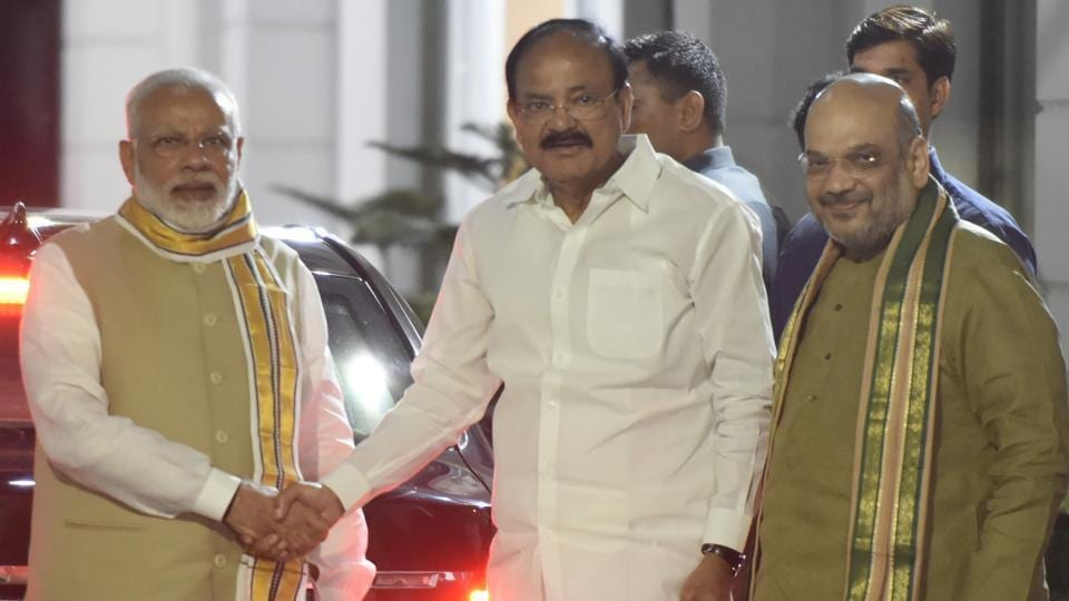 Prime Minister Narendra Modi greets M Venkaiah Naidu after he was named the NDA's vice-presidential candidate by BJP president Amit Shah on July 17. The election will be held on August 5.