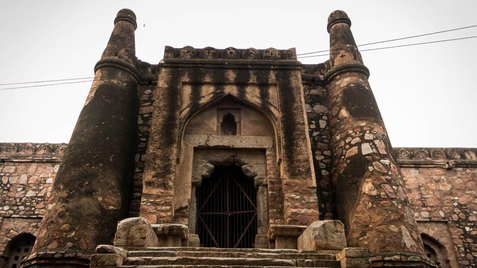 A stone's throw away from Select Citywalk --one of Delhi's most frequented shopping malls, in the narrow bylanes of Khirki village stands a Tuqhlaq-era structure, constructed in the 14th century to serve as a house of worship and also a fortress. Hidden from view and the city's memory, this crumbling monument is the Khirki Masjid. (Abhirup Biswas / HT Photo)