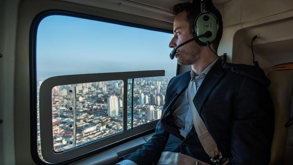 Brazilian businessman Gustavo Boyle flies over Sao Paulo, Brazil on June 23. Airbus' subsidiary Voom gives an alternative for those willing to avoid Sao Paulo's heavy car traffic, offering a helicopter service similar to the car service offered by Uber.