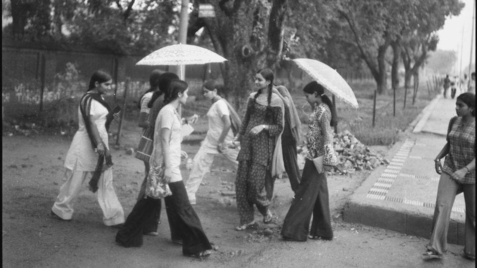 Freshers  wearing bell bottoms on their first day  at Delhi University in the year 1976. Greater focus on personal image has made Day one a pricey affair for students, with many willing to spend in the thousands to look their best as they enter university life. (Virendra Prabhakar / HT photo )
