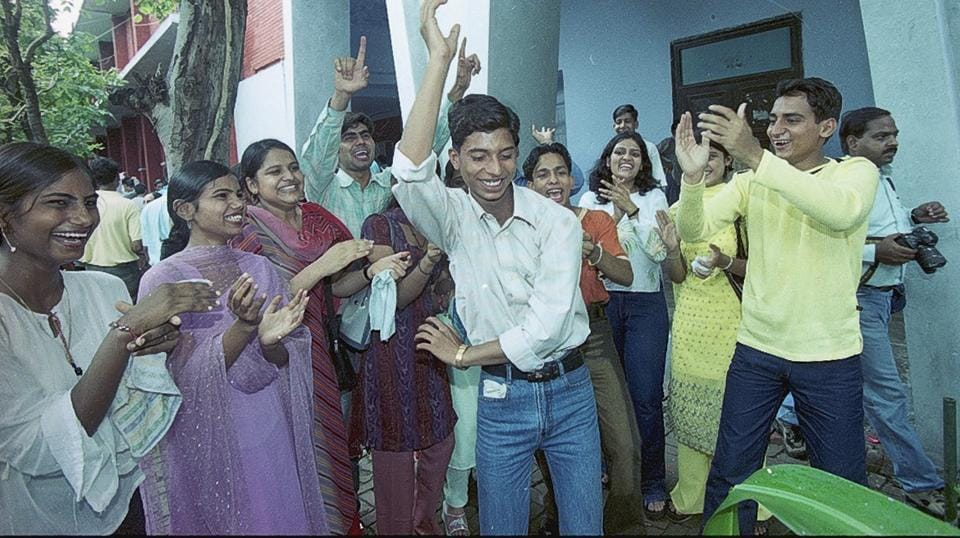 Senior students  make juniors dance while ragging on the first day of college in the year 2003. After the ban on ragging across universities, interactions between freshers and their seniors have taken the form of informal intro sessions. (S Burmaula / HT Photo)