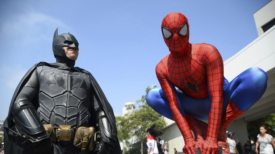 Dorian Black, left, dressed as Batman and Kyle Blankenfield, dressed as Spider-Man appear outside during Comic-Con International in San Diego.