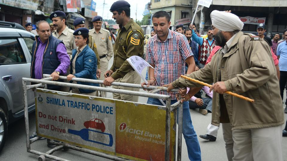 News of his death sent ripples of anger through the Himalayan state as people shouted slogans, clashed with police and blocked arterial roads, demanding an overhaul of what protesters deem a shoddy probe. Locals staged a 'chakka jam' at Dhalli, Shimla, on Wednesday.  (Deepak Sansta/HT Photo)