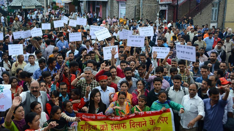 Nagrik Sabha staged a protest at Mall road in Shimla, on Wednesday, demanding an overhaul of what they deem a shoddy probe . (Deepak Sansta/HT photo)