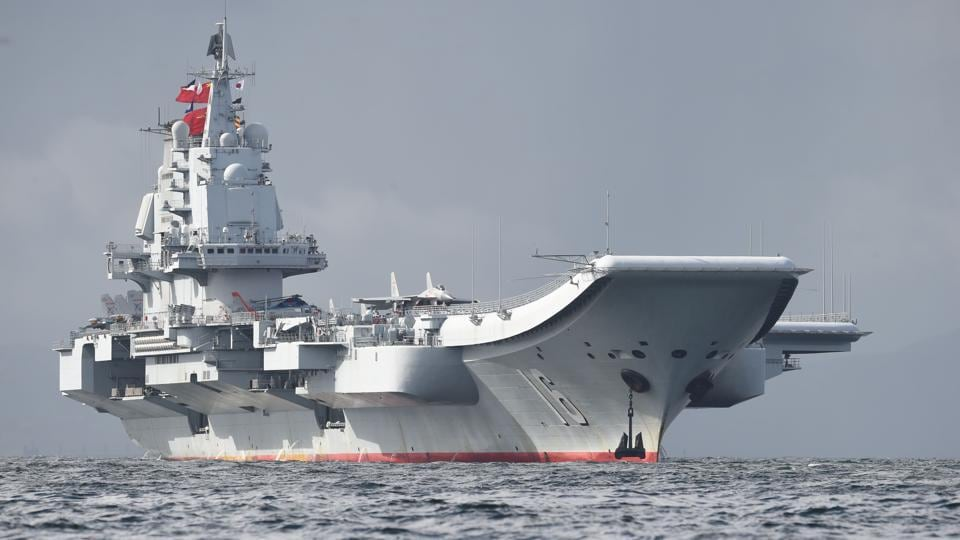 China's sole aircraft carrier, the Liaoning, arrives in Hong Kong waters on July 7, 2017. China's national defence ministry had said the Liaoning was part of a flotilla on a