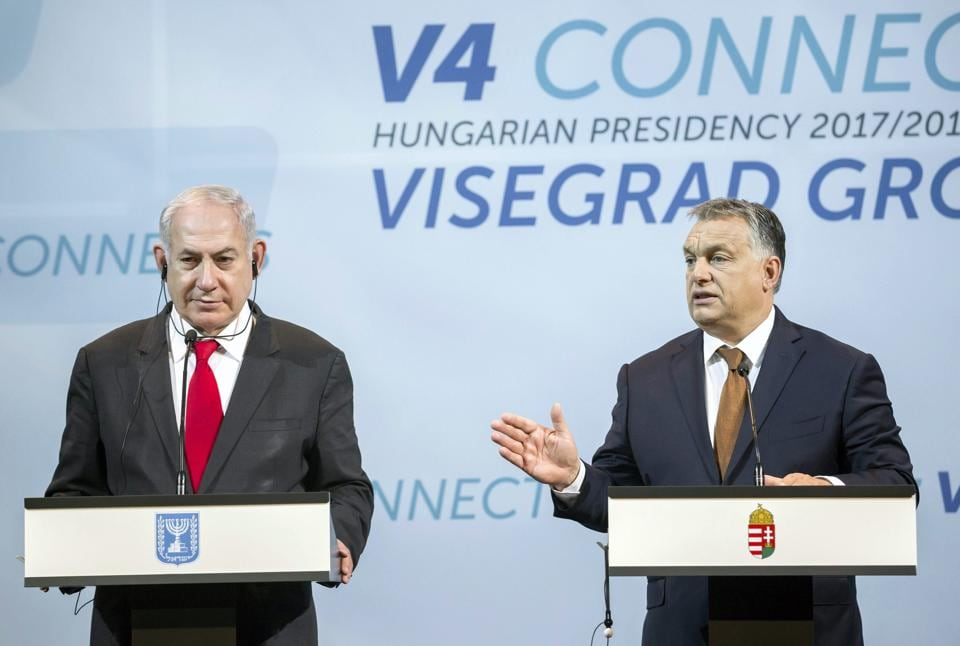 Israeli Prime Minister Benjamin Netanyahu (left) listens to Hungarian Prime Minister Viktor Orban during a press conference in Budapest on July 19, 2017.
