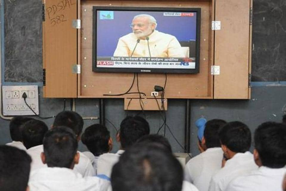 Students listening to Prime Minister Narendra Modi's 'Mann Ki Baat' programme at Government Senior Secondary School, Ladowali.