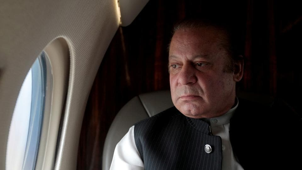 Pakistani Prime Minister Nawaz Sharif looks out the window of his plane after attending a ceremony to inaugurate the M9 motorway between Karachi and Hyderabad.