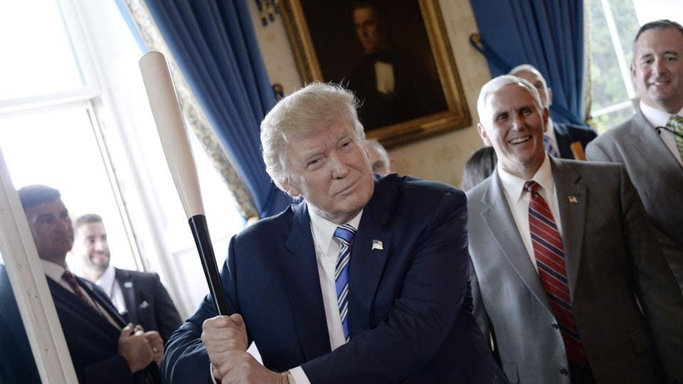 President Donald Trump holds a Marucci baseball bat in the Blue Room during a 'Made in America' product showcase event at the White House in Washington, DC, on July 17, 2017.