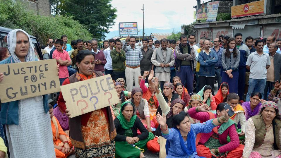 People block a road in Shimla on Wednesday during a protest demanding justice for a 16-year-old schoolgirl who was allegedly raped and murdered earlier this month.
