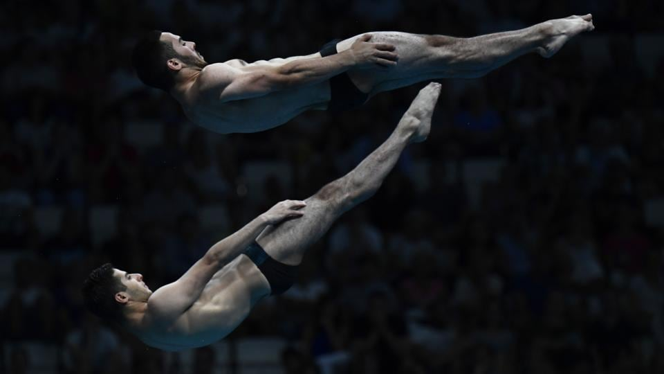 Armenia's Vladimir Harutyunyan and Armenia's Lev Sargsyan compete in the men's 10m platform synchro final during the diving competition. (AFP)