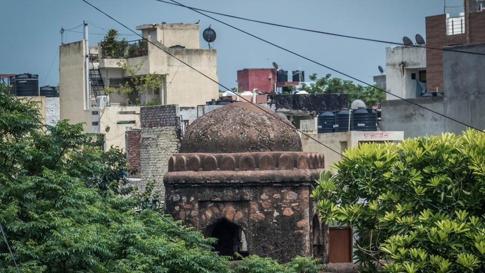 A remnant of the medieval Jahanpanah city, the Khirki Masjid, dwarfed by matchbox like buildings now jostles for space and attention from locals and visitors alike to the vibrant locality that surrounds this monument.  (Abhirup Biswas / HT Photo)