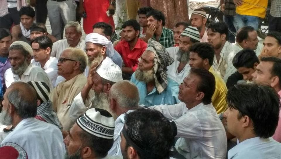 Villagers held a sit-in protest outside Jewar police station.