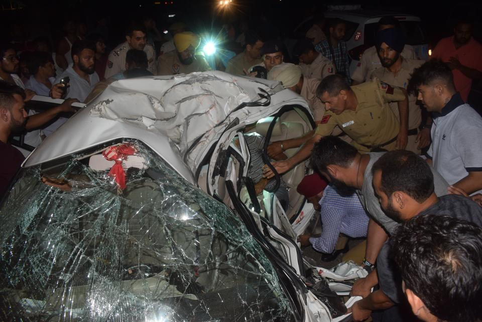 Police trying to rescue the victims from the badly damaged car after the mishap in Chandigarh.