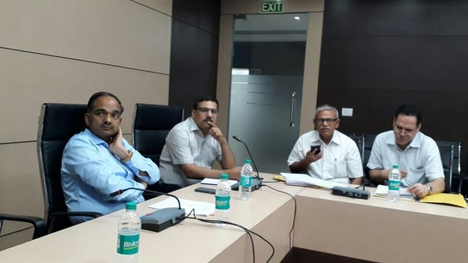 UPPCL chairman/principal secretary, energy, Alok Kumar (first from left) and managing director Vishal Chauhan having a look at the power situation at the state load dispatch centre  in Gomtinagar Lucknow.