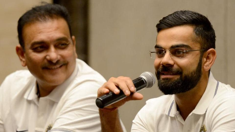 Indian cricket team captain Virat Kohli (R) and newly appointed coach Ravi Shastri addressed the press before their departure for Sri Lanka. (AFP)