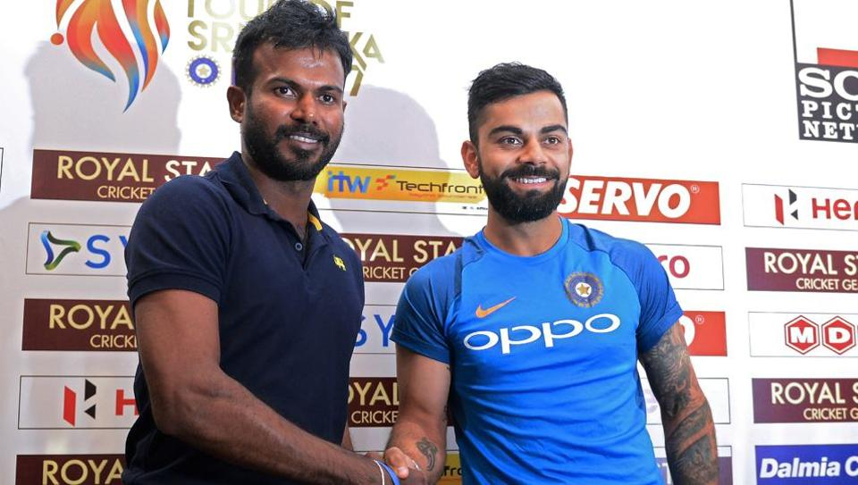 Indian cricket team captain Virat Kohli (R) shakes hands with Sri Lankan one-day international (ODI) and Twenty20 captain Upul Tharanga during a press conference in Colombo on Thursday. India will play three Tests, five one-day internationals and a Twenty20 in Sri Lanka. The first Test starts on July 26 in Galle.