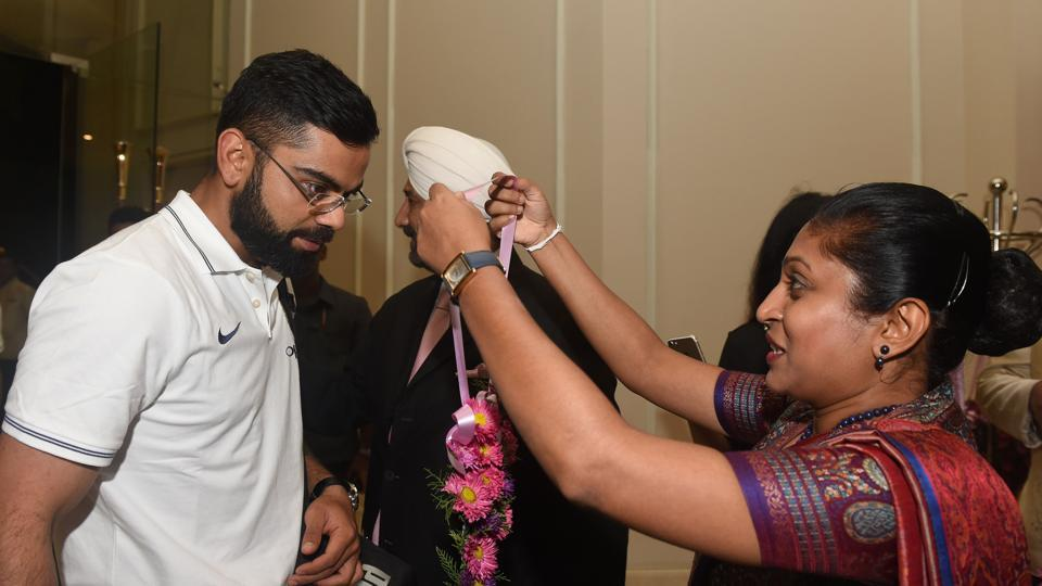 Virat Kohli, India captain, is given a traditional welcome as he arrives with teammates at a hotel in Colombo. His first overseas Test series win as captain came in Sri Lanka.  (AFP)