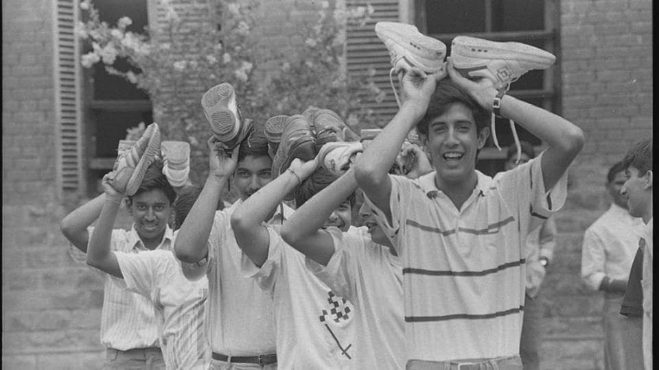 Students undergo ragging on their first day at a college in Delhi University, 1991.  As Delhi University opens its gates to a new batch of students at the cusp of college life, we sift through the HT archives, looking back at the trends and experiences that make up university life. (Arun Jetlie /  HT photo  )